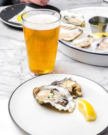 Swift & Sons Tavern and Oyster Bar best chicago rooftop restaurants;