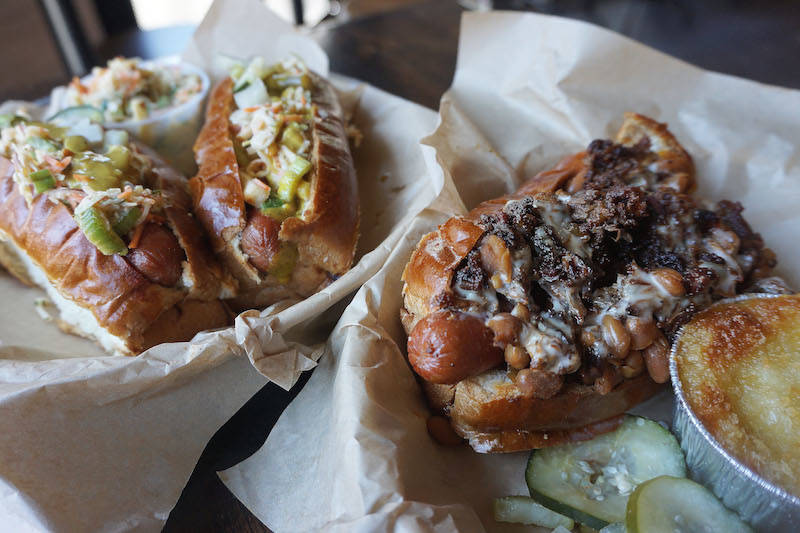 Weekday Planner: Hot Dog Crosstown Classic, Curious George Happy Hour, Band of Bohemia's Bar Menu and Pizza Nights at The Duck Inn
