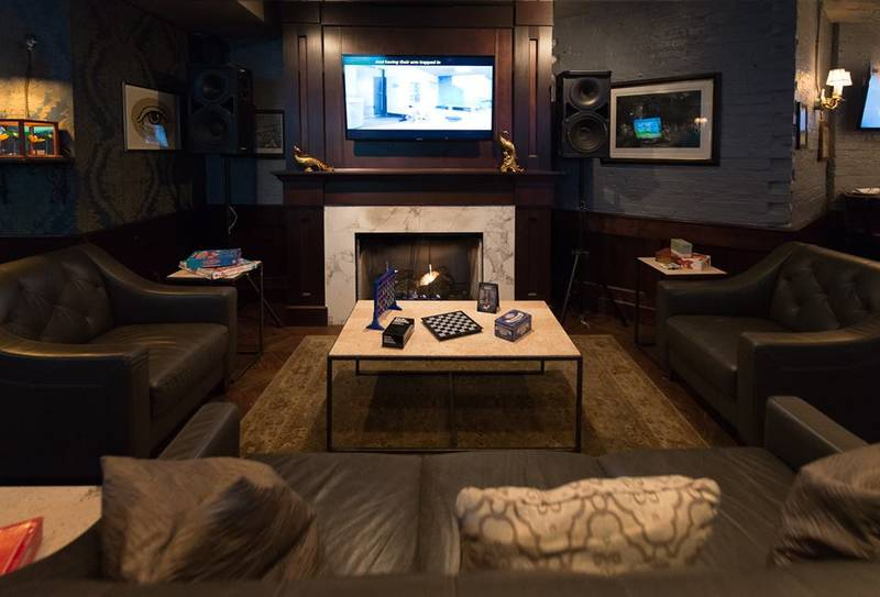 The fireplace at Lark is where guests congregate to place games and eat chili-stuffed potato skins during winter.